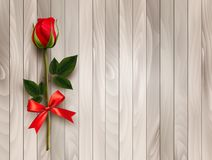 Happy Valentine's day. Beautiful red rose and gift bow Royalty Free Stock Photo