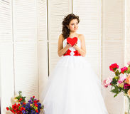 Happy Valentine's Day. Bride with red heart. Wedding and Valentine concept. Stock Photos