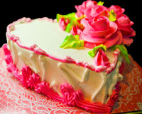 Happy valentine's day cake. Happy valentine's day or birthday cake with rose decor. black background Stock Photography