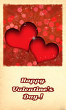 Happy Valentine's day card. /Retro  with two red hearts and burst behind them, on old paper like background Royalty Free Stock Image