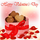 Happy Valentine`s Day card with box of cookies, pearls and rose petals. Background for valentine`s day. Greeting card in Stock Photo