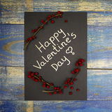 Happy Valentine`s Day card decorated with wild rose fruits Royalty Free Stock Image