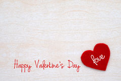 Happy valentine`s day card and fabric heart shape on white wood Royalty Free Stock Photos