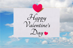 Happy Valentine's Day card with sky background. Pattern for Happy Valentine's Day card with sky background and white sheet of paper held by heart shaped pin Stock Photography