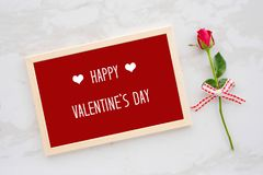 Happy valentine`s day card in wooden frame and red rose on white Royalty Free Stock Photography