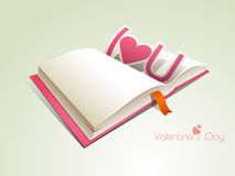 Happy Valentines Day celebration with blank book and text. Stock Photo