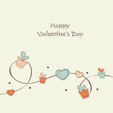 Happy Valentines Day celebration with gifts and hearts. Stock Photos