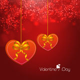 Happy Valentines Day celebrations with hanging hearts. Stock Photos