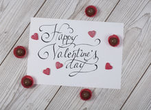 Happy Valentine`s day concept with praline. Happy Valentine`s day concept card with praline on white wood royalty free stock images