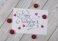 Happy Valentine`s day concept with praline. Happy Valentine`s day concept card with praline on white wood stock photos