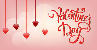 Happy Valentine`s Day greeting card. Hanging red hearts on gentle pink background Stock Photography