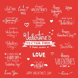 Happy Valentine's Day Hand Lettering set. Happy Valentine's Day Hand Lettering - Typographical Background Set  On Chalkboard with ornaments, hearts, ribbon Royalty Free Stock Image