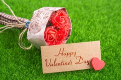 Happy valentine`s day. In card with heart and bouquet on grass Royalty Free Stock Photography