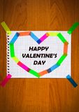 Happy Valentine`s Day inscription black color card sheet of notepad paper in heart shape on the wooden background Royalty Free Stock Image