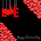 Happy Valentine`s Day, love hanging on a ropes and hearts Stock Photography