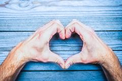 Heart in hands on  day in love. A happy valentine`s day in love and heart hands stock photo