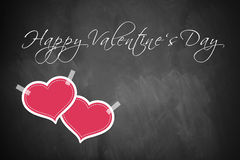 Happy Valentine's Day. Message and two hearts on a blackboard Stock Photography