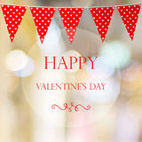 Happy valentine`s day over blur bokeh and red bunting party flag Royalty Free Stock Image