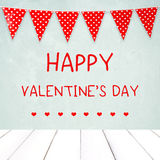 Happy valentine`s day over green wall and red bunting party flag Royalty Free Stock Image