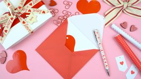 Happy Valentine`s Day overhead flat lay writing card.