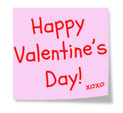 Happy Valentine's Day Pink Sticky Note. A pink sticky note with the words Happy Valentine's Day and XOXO making a great Valentine or Love concept Royalty Free Stock Photo