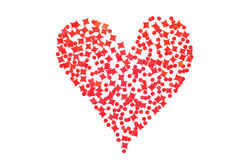 Happy Valentine's Day! Red heart made of small peaces of plastic. Stars, dots, on a white background Royalty Free Stock Image