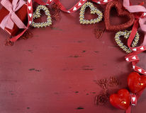 Happy Valentine's Day red vintage wood background. With gold hearts and ribbons decorations, with copy space for your text here Stock Images