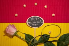 Happy Valentine`s Day with rose and pearls royalty free stock image