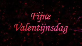 Happy Valentine's Day text in Dutch Fijne Valentijnsdag formed from dust and turns to dust horizontally on dark background stock footage