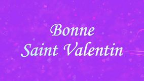 Happy Valentine's Day text in French Bonne Saint Valentin formed from dust and turns to dust horizontally on purple background stock video footage