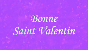 Happy Valentine's Day text in French Bonne Saint Valentin on purple background Royalty Free Stock Images