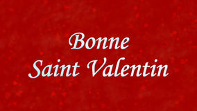 Happy Valentine's Day text in French Bonne Saint Valentin on red background Stock Images