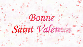 Happy Valentine's Day text in French Bonne Saint Valentin turns to dust from right on light background Royalty Free Stock Photos