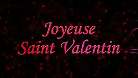 Happy Valentine's Day text in French Joyeuse Saint Valentin formed from dust and turns to dust horizontally on dark background stock video footage