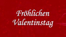 Happy Valentine's Day text in German Frohlichen Valentinstag formed from dust and turns to dust horizontally on red background stock footage