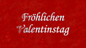 Happy Valentine's Day text in German Frohlichen Valentinstag turns to dust from left on red background Royalty Free Stock Photography