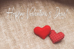 Happy Valentine`s day text.Hearts made with hands. Background for Valentine`s day Stock Images