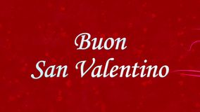 Happy Valentine's Day text in Italian Buon San Valentino formed from dust and turns to dust horizontally on red background stock video footage