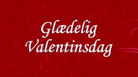 Happy Valentine's Day text in Norwegian Glaedelig Valentinsdag formed from dust and turns to dust horizontally on red background stock video