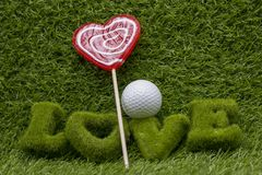 To golf with love on green grass. Happy Valentine`s day to golfer on green course Royalty Free Stock Image