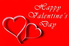 Happy Valentine's Day - white paper hearts on red background Stock Photos