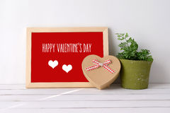 Happy valentine`s day on wood board and heart shape gift box on Stock Photography