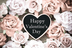 Happy valentine's day wooden tag with roses. Happy valentine's day wooden tag with roses on sack background vintage style Stock Photos