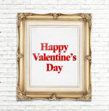 Happy Valentine's Day word in golden vintage photo frame on white brick wall,Love concept. Stock Photos