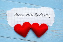 HAPPY VALENTINE`S DAY word on paper note with couple red heart shape decoration on blue wooden table background. Wedding, Romanti royalty free stock images