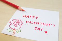 Happy Valentine's Day wording in small paper with red crayon Stock Images