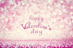 HAPPY VALENTINE`S DAY writing on pink background. HAPPY VALENTINE`S DAY handwriting on pink sparkly background. Celebrating love, holiday wishes royalty free stock image