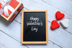 Free Happy Valentine`s Day Written On A Chalkboard With Wooden Handraft Heart And Box Royalty Free Stock Image - 109471066