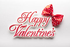 Happy Valentine`s - inscription cut from paper and red bow Royalty Free Stock Images