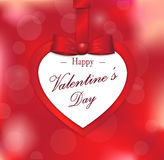 Happy Valentine's paper card on blurred background with red gift bow and ribbon Stock Photos